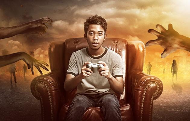 Pojke i stol med konsol-kontroll i handen omringad av zombies